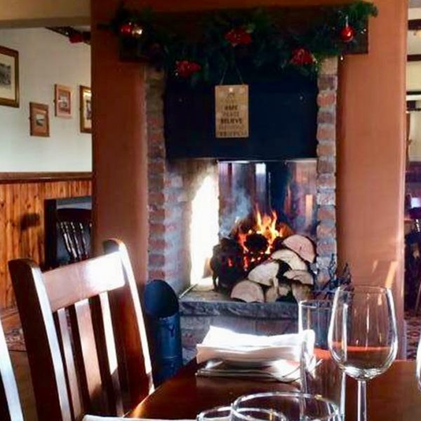 Sit by the fire at The Drover's Arms